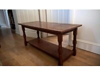 Solid dark wood, high quality. detailed coffee table.