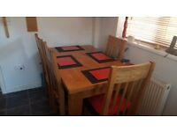 Solid oak extending dining/kitchen table and 4 chairs