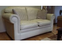 Cream leather sofa.