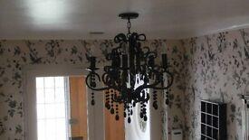 Pair of ornate black chandeliers