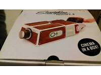 Smartphone projector in a box