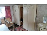 cream bedroom suit - wardrobes, dresser, bedside table.