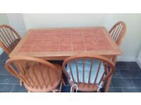 Wooden kitchen table and 4 chairs, tiled top. Used but in good condition