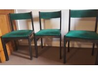 Green cushion wooden chairs