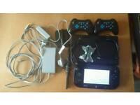 Nintendo Wii U 32gb and eight games