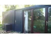 1/2 bed converted shipping container cabin with kitchen, bathroom, full electrics and plumbing.