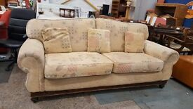 Beige large patterned fabric two seater
