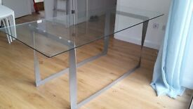 Very stylish urban chic glass and steel dining table