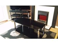 Matching set of black glass living room furniture, coffee table, TV stand and nest of tables