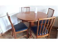 Table ( extendable for additional 2 spaces)and 4 chairs