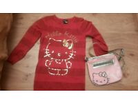 Girls age 7 to 8 red log line Hello Kitty jumper and Hello Kitty bag