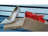 Louboutin high heels size 6.5 white spikes