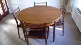 Round Teak extending table and 4 chairs