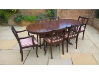 Extendable mahogany dining table with 6 matching chairs