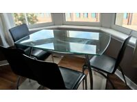 Glass table and four black chairs - free