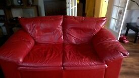 Two 2-Seater red leather sofa's with matching foot stool.