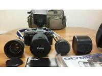 Olympus OM 10 camera kit plus accessories.