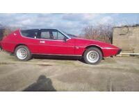 Red Lotus Elite 1975. Part restored, re upholstered, repainted