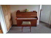 Kemble piano and stool.