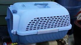 Medium size dog (or cat) plastic cage.