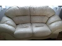 Cream leather sofa -two seater