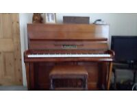 A lovely teak piano in excellent condition for its age