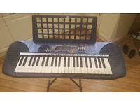 YAMAHA KEYBOARD PSR-140 COMES WITH MULTIPLE ACCESSORIES