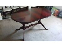 Extending Rosewood Dining table and 5 matching chairs