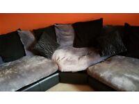 Corner sofa grey material and black leather