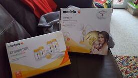 Medela swing single electric breastpump (used) Medela breastmilk store and feed set (unopened)