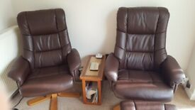 2 brown faux leather swivel, reclining chairs and matching footstools.