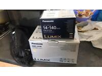 Panasonic lumix DMC-G5W Plus the lens is really in a good condition pls text or contact call