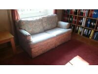 Double Sofa Bed, ex M&S, reasonable condition. Floral (tapestry) blue, greens & red.