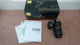 Nikon D3100 with kit lens (18-55mm)