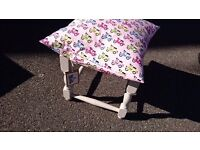 Small footstool with cushion