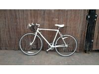 Vintage Raleigh Road Bike in Great Condition! Includes lock, lights, helmet, bell. Fits tall rider