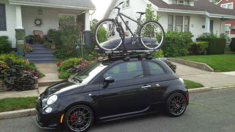 An example of a bike & roof box being carried together.