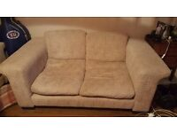 Two light beige fabric 2-seater sofas for sale