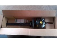 Brand new still in the box.Webb 25.4cc double bladed Petrol hedge cutter.