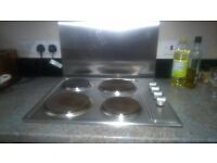 Electric hob with 4 metal rings
