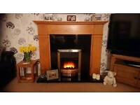 Electric fire with Oak surround and granite hearth and back panel