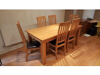 Solid oak dining room table (1800mm x 900mm) and 6 leather and oak chairs