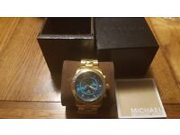 Brand new genuine unisex Michael Kors watch in Box......