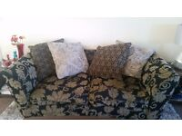 2 seat mixed black and yellow flower sofa with extra cushions good quality