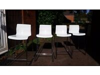 4 x Almost New Ikea stools/breakfast bar stools. Metal legs and White plastic seat. Height 65cm