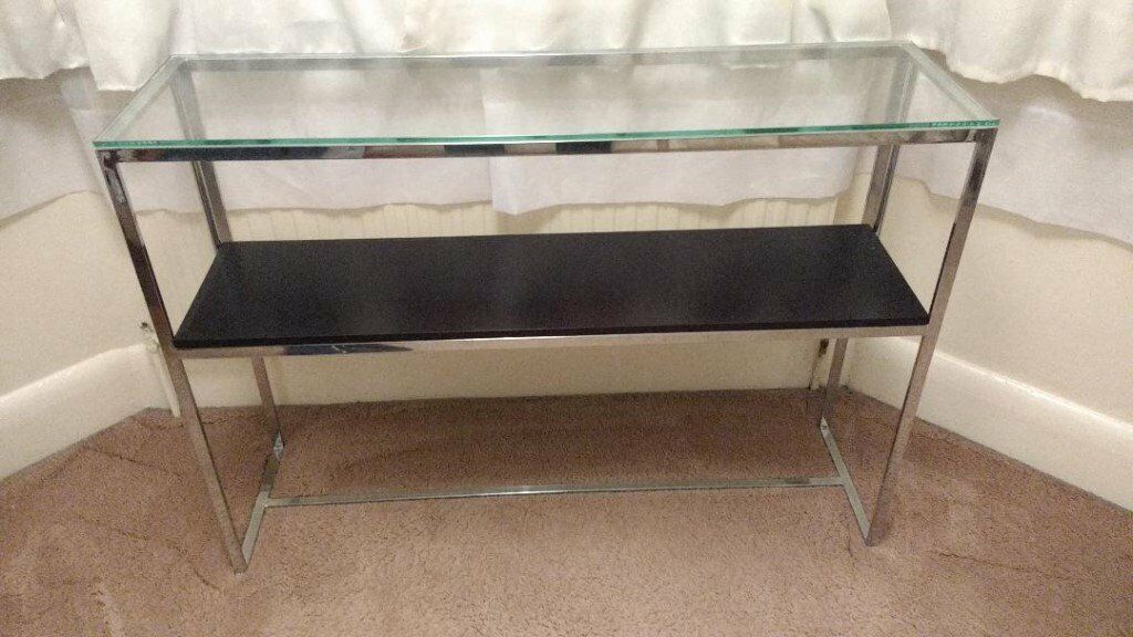 Small glass and steel table