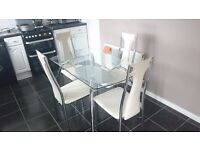 Glass table with four chairs for sale