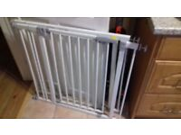 Two Hauck pressure-fit stair gates. No need for drilling. Comes with additional extensions.