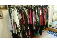 A whole rail of clothes ideal for a car boot