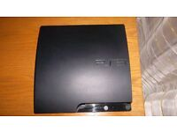 Sony Playstation 3 slim console, controllers and 10 games